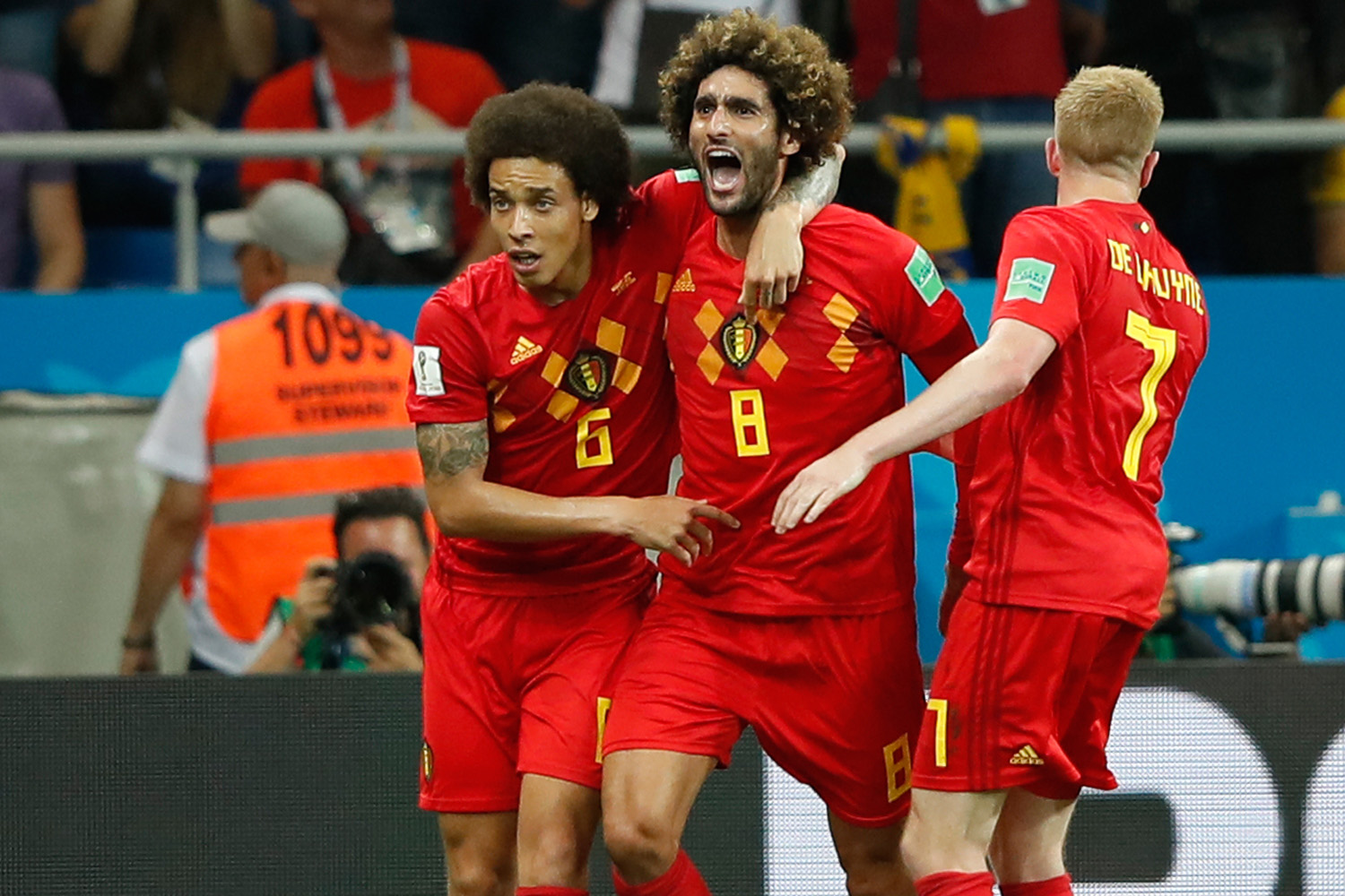Belgium's Axel Witsel Marouane Fellaini and Kevin De Bruyne applaud their side's equalizer opposite Japan