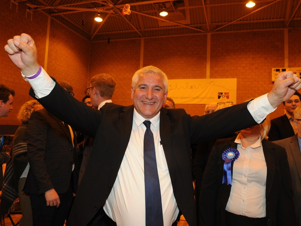 Dudley Conservative personality Patrick Harley celebrates during a count during Crystal Leisure Centre