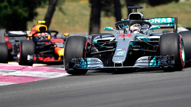 Lewis lays down early pen in hunt for Vettel